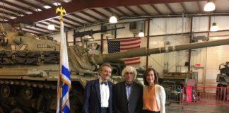Legislator Ellen Birnbaum, Yuval Neria, and Rabbi Harvey Abramowitz commemorate the 45th anniversary of the Yom Kippur War.