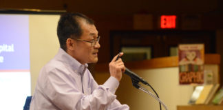 Great Neck resident Bill Lin, who said he has spent most of his adult life in the corporate world, said the board's decision to install a parking lot was based on anecdotes rather than data. (Photo by Janelle Clausen)