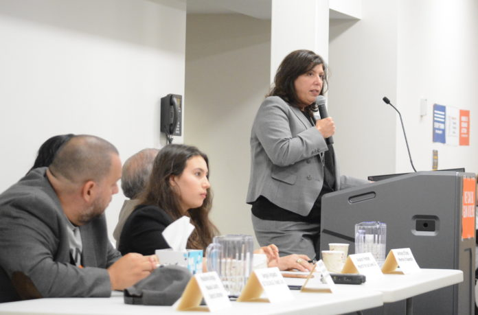 Nassau County DA Madeline Singas and other panelists addressed an audience at a gun violence prevention forum at the Great Neck Library on Thursday. (Photo by Janelle Clausen)