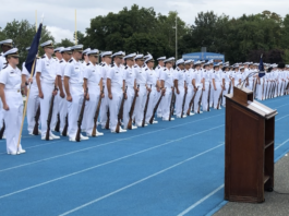 U.S. Navy Capt. Steven Urwiller speaks to the U.S. Merchant Marine Academy Class of 2022 prior to swearing them in as Midshipmen in the U.S. Navy Reserve. Urwiller spoke at the Academy's Toom Field during Parents Weekend. (Photo courtesy of the U.S. Merchant Marine Academy)