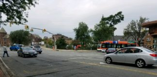 A pedestrian begins to cross the intersection of Middle Neck Road and Station Plaza. (Photo by Janelle Clausen)