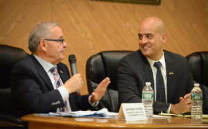 Anthony D'Urso and Byron Divins speak at Wednesday night's Meet the Candidates event. (Photo by Janelle Clausen)