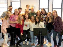Fiona Lyngstad-Hughes and Maggie Roach were among the high school students selected to perform at the Broadway Back to School benefit in New York City on Sept. 23. The student participants are pictured here with Broadway actor Hunter Bell, in center, who served as emcee and co-producer for the event. (Photo courtesy of the Great Neck Public Schools)