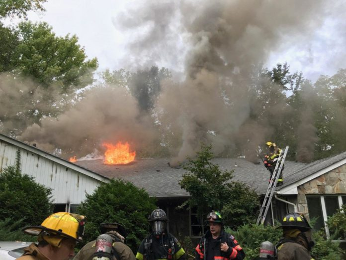 Firefighters battle a blaze at 920 Middle Neck Road. (Photo courtesy of Steven Schwartz)