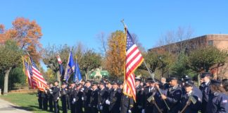 Members of Great Neck's fire departments marched in the Veterans Day parade and paid tribute to those who have served. (Photo by John Nugent)
