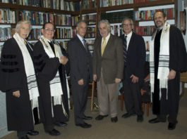 Arthur Flug posed for a photograph with religious and temple leaders before Temple Emanuel's Kristallnacht service. (Photo courtesy of Temple Emanuel)