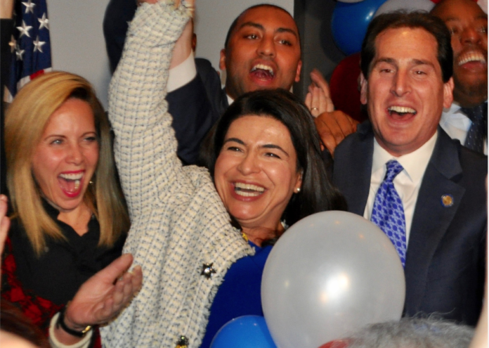 Anna Kaplan, flanked by Hempstead Supervisor Laura Gillen and state Sen. Todd Kaminsky, is declared the victor of the state Senate District 7 race at the Democrats' election party in Garden City. (Photo by Luke Torrance)