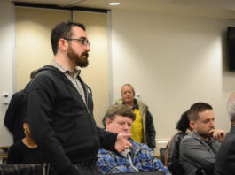 Eliot Friedman, 29, speaks up about issues like healthcare and affordability at the town hall-style forum. (Photo by Janelle Clausen)