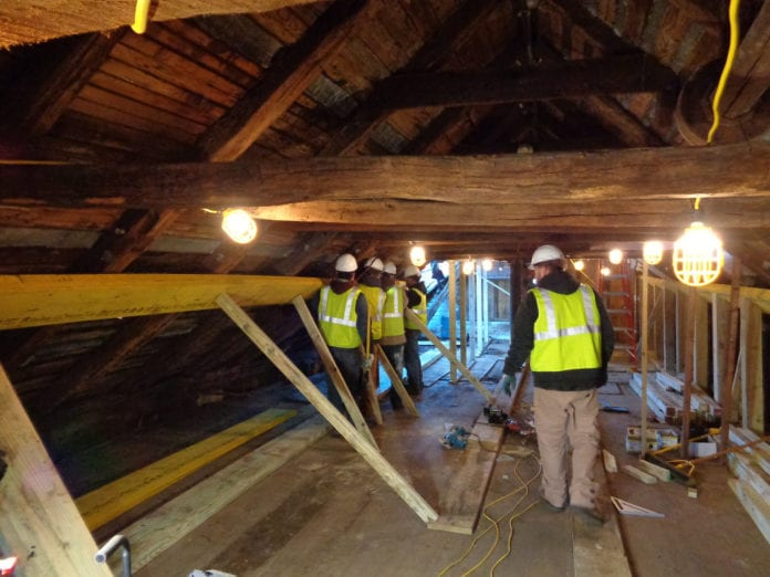 Workers stabilize the Roslyn Grist Mill's timber frame for its restoration. (Photo courtesy of the Roslyn Landmark Society)