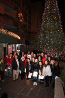 Students, dignitaries and other guests pose in front of the Inn at Great Neck's Christmas tree. (Photo by Russell Lippai)