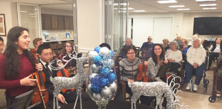 Musicians from North High School visited the Atria to perform for its residents. (Photo courtesy of the Great Neck Public Schools)