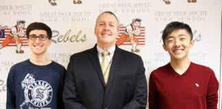South High School Principal Dr. Christopher Gitz congratulates Noah Sheidlower and Andersen Gu. (Photo courtesy of the Great Neck Public Schools)
