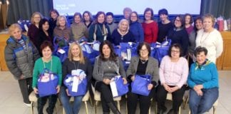 Temple Beth Sholom Sisterhood members donated and wrapped health and beauty products during its annual Chanukah party for the residents of Broken but Not Destroyed Women's Shelter in Hempstead. The women, many of whom have been the victims of domestic violence, reside in the shelter with their children while recuperating and preparing themselves to reenter the workforce. (Photo courtesy of Temple Beth Shalom)