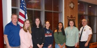 John Motchkavitz, Julia Motchkavitz, Maya Garfinkel, Lauren Murphy, Abigail Garcia, Alexandra Kessler, and Chief James Neubert. (Photo courtesy of Sara Rietbroek)