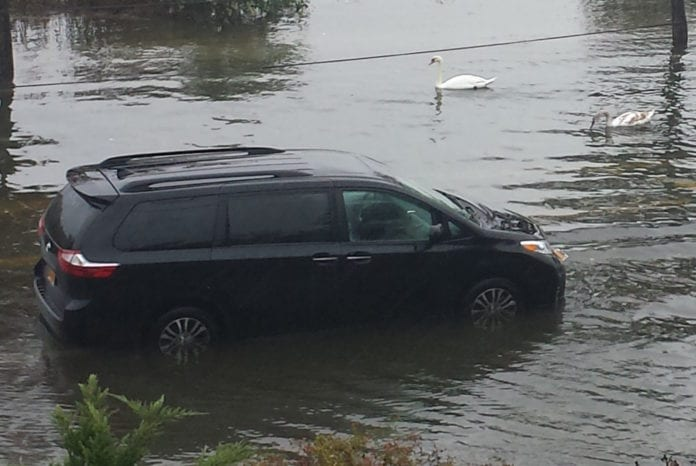 A van flooded when attempting to drive on Shore Road during a recent rainstorm. (Photo courtesy of Baxter Estates resident Maria Branco)