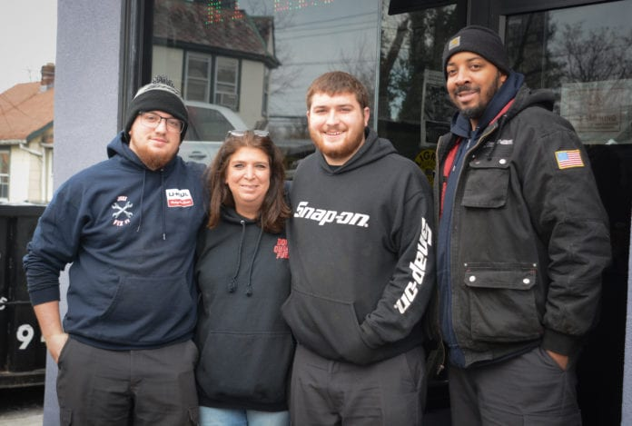 Donna Plakstis and her sons Tyler and Ryan, pictured here with employee William Robertson, will be running the family business Doray Enterprises in Great Neck for as long as it lasts. (Photo by Janelle Clausen)
