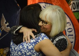 North Hempstead Town Supervisor Judi Bosworth embraces outgoing Town Councilwoman Anna Kaplan. (Photo by Janelle Clausen)
