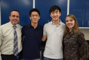 Richard Lee and Kendrick Tak pose with their advisor Alison Huenger and Thomas Elkins, Manhasset's district coordinator for science, health and technology. (Photo by Terry Gilberti)