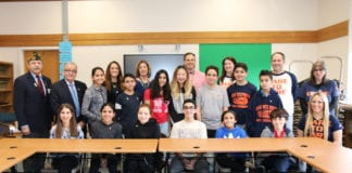 Representatives from the North Middle School Student Council are joined by Assemblyman Anthony D'Urso and Vietnam veteran Jack Hirsch; Principal Gerald Cozine and Assistant Principals Nancy Gunning and Jennifer Andersen; and Student Council Advisors Michelle Sicurella, Michael Noberto, Betty Brody, and Rachael Weissman. (Photo courtesy of the Great Neck Public Schools)