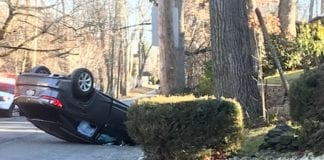 A car accident on Beach Road near Great Neck North High School left a vehicle overturned, but no serious injuries. (Photo courtesy of Ruth Gebay)