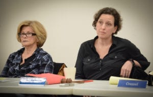 Great Neck Library Board President Rebecca Miller, pictured here with Trustee Josie Pizer, listens as residents air their concerns over the director's resignation. (Photo by Janelle Clausen)