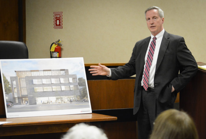 Chris Prior, a legal representative for Spiegel Associates, presents an artist's rendering of its proposed 16 Maple Drive development. (Photo by Janelle Clausen)