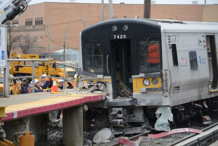 Three people were killed in a fatal crash before this LIRR train derailed and collided with the Westbury train station platform. (Photo by Janelle Clausen)