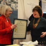 Town Supervisor Judi Bosworth goes to present Kasten with a town citation. (Photo by Janelle Clausen)
