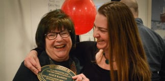"Alice Kasten and her daughter Meredith Zolty joke about how Kasten, who received a plaque normally given only to historical landmarks or buildings, is now a ""landmark."" (Photo by Janelle Clausen)"