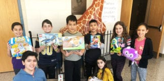 As part of the school's Kindness Week activities, the Student Council and the JFK PTA sponsored a toy drive to benefit several children's hospitals. (Photo courtesy of the Great Neck Public Schools)