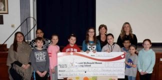John Lewis Childs School Student Council members are pictured with adviser Kelly Zullo, Principal Susan Fazio and Ronald McDonald House of Long Island Development Manager Jovann Dixon and Hospitality and Event volunteer Joanne Wolfring. (Photo courtesy of the Floral Park-Bellerose School District)
