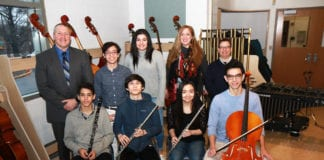 South High School musicians Eli Goldberger, Samuel Levine, Christiana Claus, Nicholas Langel, Benjamin T. Rossen, and Daniella Brancato are photographed with Principal Christopher Gitz, Janine Robinson, vocal music instructor, and Michael Schwartz, performing arts department chair. (Photo courtesy of the Great Neck Public Schools)