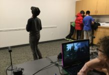 Teens trying out the virtual reality relaxation environment created by Team Dream at Levels. (Photo courtesy of the Great Neck Library)