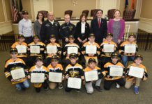 Superintendent Jason R. Marra, Commissioners Tina Stellato, Robert Lincoln, Jr., Frank Cilluffo, Council Member Lee Seeman, Town Clerk Wayne Wink and Council Member Veronica Lurvey are pictured with the victorious Great Neck Bruins. (Photo courtesy of the Town of North Hempstead)