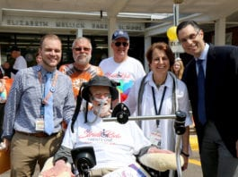 Ride for Life honoree Christopher Lynch (left) is photographed with Ride for Life founder Christopher Pendergast (center), Ride participants Paul Weisman and Nelson Colon, retired Baker Principal Sharon Fougner, and current Baker Principal Dr. Michael Grimaldi during the Ride for Life visit to E.M. Baker School in May 2018. (Photo courtesy of Great Neck Public Schools)