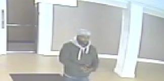 Police say this man, shown on video surveillance at about 1:46 a.m., is suspected of committing multiple burglaries in the same apartment complex. (Photo courtesy of Nassau County Police Department)