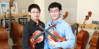 Mark Xu and Matthew Xu, both juniors at North High School, were selected to perform with the 2019 Honor Orchestra of America. (Photo courtesy of the Great Neck Public Schools)