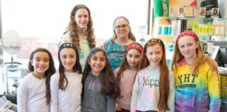 Yeshiva Har Torah held a group hair donation event on Wednesday, with students, staff and parents giving hair to an Israeli charity to make wigs for children with cancer. (Photo by Eli Schilowitz)