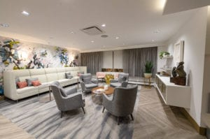 The Friedman Center's waiting area features couches with throw pillows, accent chairs, coffee tables as well as custom artwork. (Photo courtesy of Northwell Health)