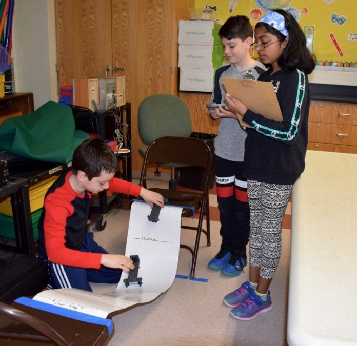 Manor Oaks School students Mateo Mrakovcic (left), Alexander Fulgieri and Meera Lal (right) teamed up to test collisions during an Energy and Collision module. (Photo courtesy of the New Hyde Park-Garden City school district)