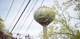 Final touches are being put on Williston Park's new water tower, which is expected to go online on June 1. (Photo by Janelle Clausen)