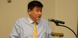 James Wu, who is challenging Mayor Pedram Bral, faced questions over campaign finance violations related to a race in Queens at a campaign forum Tuesday night. (Photo by Janelle Clausen)