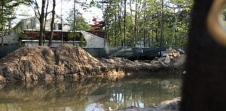 A property in the Village of Great Neck has filled with water over a course of months, in effect creating a pool where a home would otherwise be. (Photo provided to the Great Neck News)