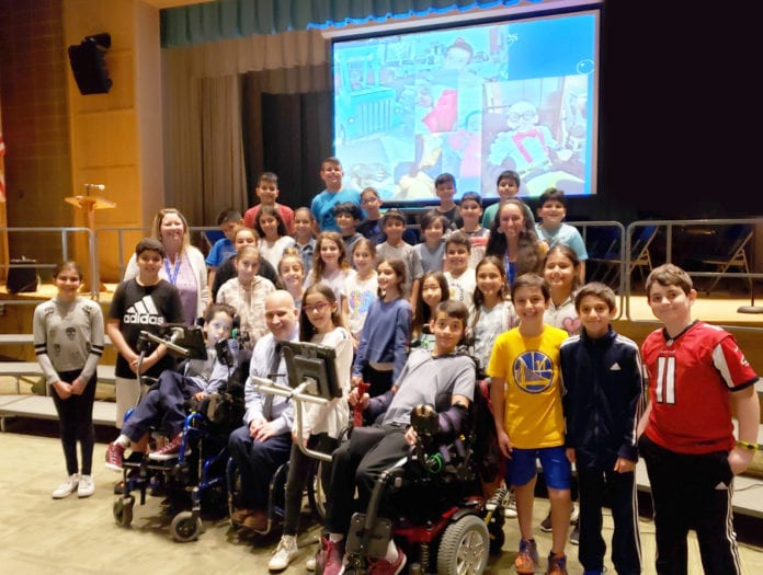 Representatives from the Viscardi School are photographed here with JFK Assistant Principal Michelle Bell, fifth-grade teacher Rebecca Schapira, and fourth and fifth-grade members of the JFK Student Council. (Photo courtesy of Great Neck Public Schools)