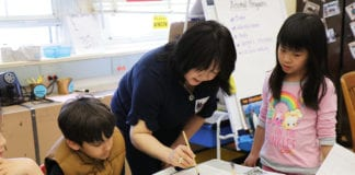 Angela Pian teaches Chinese Calligraphy to Ms. Seiden's third-grade class as part of the Lakeville School's annual Teach-In event. (Photo courtesy of Great Neck Public Schools)