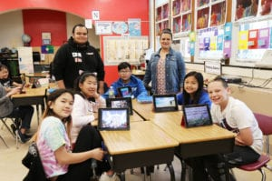Fifth graders in Ms. Ayende's class learn about photo editing and graphic design from Brandon Ayende as part of the Lakeville School's annual Teach-In event. (Photo courtesy of Great Neck Public Schools)