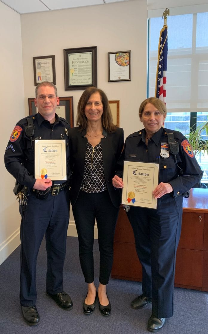 Legislator Ellen Birnbaum recently welcomed Nassau County Auxiliary Police Department volunteers APO Linda Halas-Kaplan and PFC Jonathan Levy to her office, where she presented them with Nassau County citations in recognition of recently receiving the department's 500-Hour Service Award. (Photo courtesy of Nassau County Legislator Ellen Birnbaum's office)