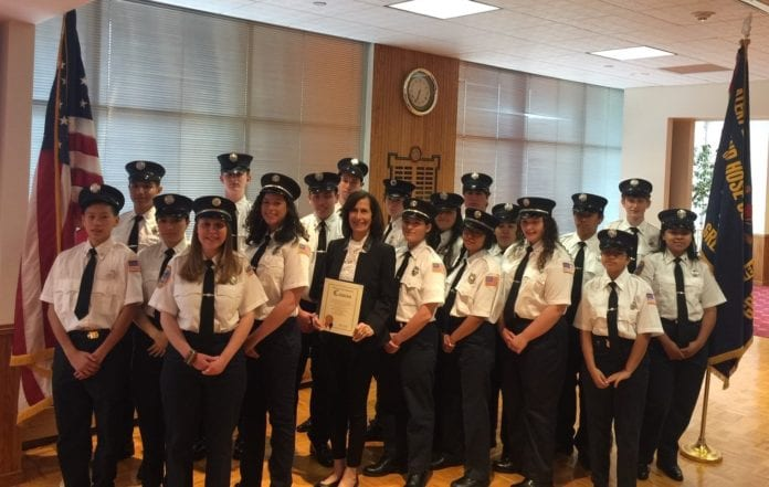 Nassau County Legislator Ellen Birnbaum congratulated the Great Neck Alert Junior Firefighters for being recognized as the top program of its kind in the state. (Photo courtesy of Nassau County Legislator Ellen Birnbaum's office)