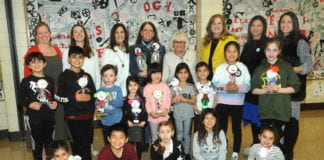 Saddle Rock kindergartners and fourth graders are joined by science teacher Janene Rowland, fourth-grade teacher Lauren Rio, kindergarten teacher Sabra Satten, Jane Barbato of The Dotty Fund, North Hempstead Town Supervisor Judi Bosworth, Great Neck Superintendent of Schools Teresa Prendergast, Saddle Rock Principal Luci Bradley and Assistant Principal Sara Goldberg. (Photo by Bill Cancellare)