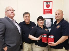 Richard Castro from the Great Neck Public Schools security department is photographed with representatives from the Nassau County Fire-Police EMS Academy following a recent training at the Phipps Administration Building. Bleeding control kits, shown here, are located in all GNPS buildings and vehicles. (Photo courtesy of Great Neck Public Schools)